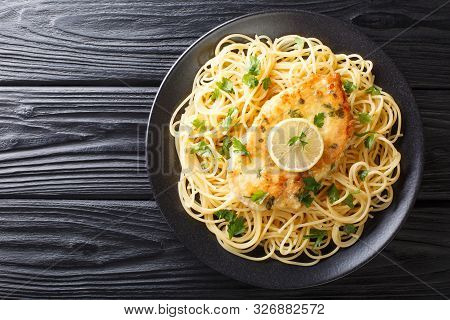 Authentic Fried Breaded Chicken Francaise With Spaghetti In Lemon Wine Gravy Close-up On A Plate. Ho