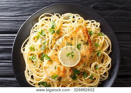 Tasty Classic Chicken Francaise With Spaghetti In Lemon Wine Sauce Close-up On A Plate. Horizontal T