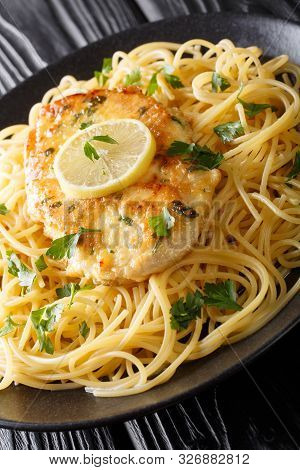 Chicken Francaise(or Chicken Francese) Is An Italian-american Dish Served With Spaghetti With Lemon