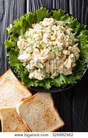 American Chicken Salad With Celery, Eggs And Onions Seasoned With Mayonnaise Close-up On A Plate. Ve