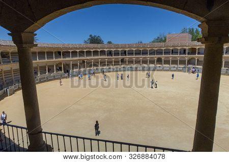 Ronda, Spain - May 17, 2018:  Visitors To The Plaza De Toros Or Bullring. The Bullring At Ronda Is T