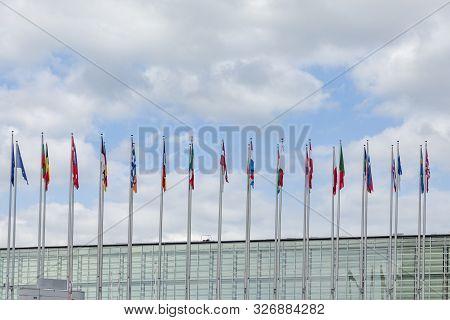 Strasbourg, France - June 18, 2018: All Eu Flags European Union Flag Waving In Front Of European Par