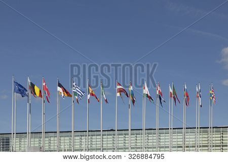 Strasbourg, France - June  23, 2018: All Eu Flags European Union Flag Waving In Front Of European Pa