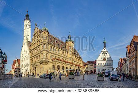 Rothenburg, Germany - Oct 6, 2018: People Visit The Central Market Place In Rothenburg Ob Der Tauber
