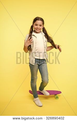 Child Smiling Face Stand On Skateboard. Penny Board Cute Colorful Skateboard For Girls. Lets Ride. G