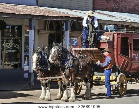 Tombstone, Arizona, Usa - Dec 3, 2011: Historic Allen Street With A Horse Drawn Stagecoach In Tombst