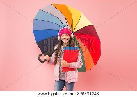 Rain Forecast On September 1. Cute Schoolgirl Colorful Umbrella On September 1. Small Child Go To Li