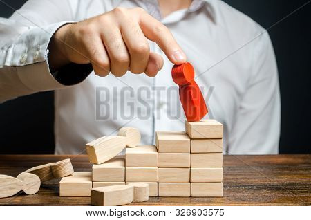 A Man Removes The Red Figure Of A Man From The Career Ladder. Poor Business Management. Employee Tur