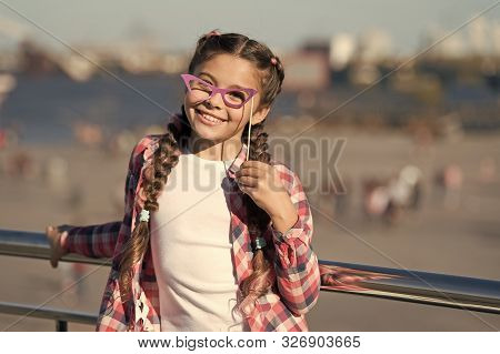 Choosing Prop Goggles Perfect For Her Style. Little Child Looking Through Fancy Goggles On Urban Bac