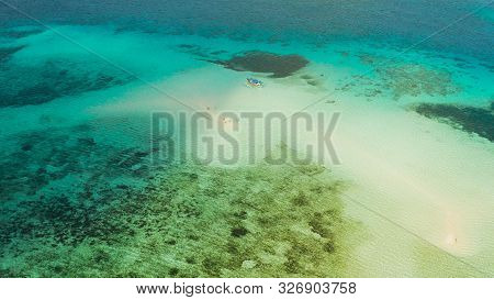 Sand Bar Among Coral Reefs In Turquoise Atoll Water, Top View. Summer And Travel Vacation Concept. B