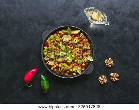 Nutty Roasted Romanesco Curry In A Iron Frying Pan. Top View.