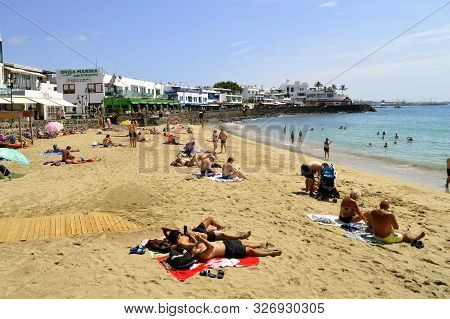 Playa Blanca, Lanzarote, Canary Islands, Spain - September 17, 2019 : Tourists Sunbathing On Plays B