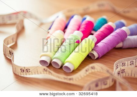 still-life shot of a colorful sewing kit poster