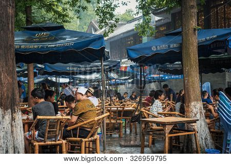 Chengdu, Sichuan Province, China - July 27, 2019 : People Having Tea In Peoples Park Famous Heming T