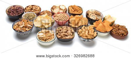 Pretzels, potato chips, crackers and other salty snacks isolated on white background