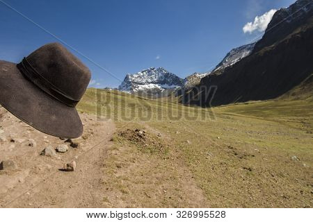 Traditional Andean Hat And Mountainous Road To Vinicunca, The Rainbow Mountain. The Hike It´s In An