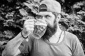 Quench thirst. Hipster brutal bearded man hold mug cold fresh beer. Alcohol drink and bar. Craft beer is young, urban and fashionable. Beer and ale concept. Man relaxing enjoying beer hot summer day poster