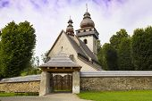 Ancient historical  Gothic Church of the Presentation of the Lord  outside - one of the most valuable religious monuments in Slovakia,  village Smrečany, Liptov region, Slovakia. poster