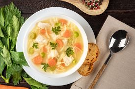 Chicken Noodle Soup, Shot From The Top On A Dark Rustic Wooden Background With A Place For Text
