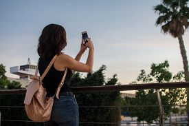 Young Woman Is Taking A Picture With Her Mobile