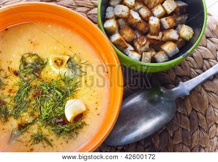 Traditional Czech fish chowder in the painted ceramic bowl.
