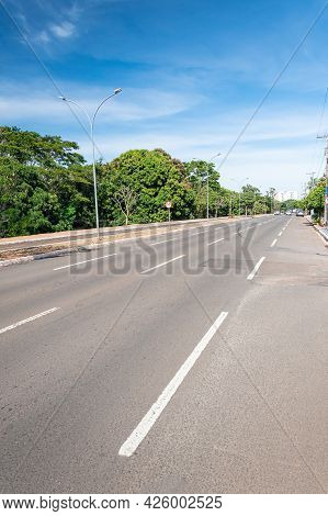 Large Avenue With A Separated Bike Lane And Green Trees Around. Nelly Martins Avenue At Campo Grande