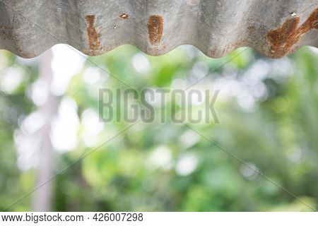 Rusted Zinc Roof On Natural Bokeh Background