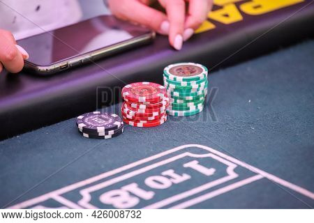 Minsk. Belarus - 25.06.2021 - Playing Chips From The Casino On A Roulette Table