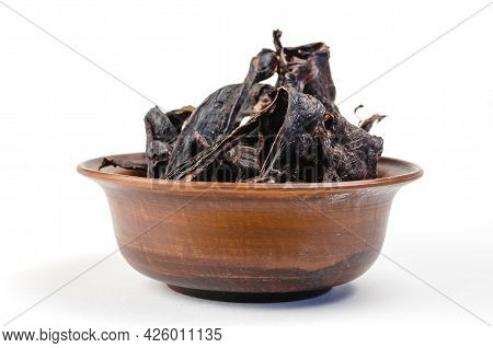 Dried Dog Treats In A Brown Clay Bowl On A White Background. Thin Slices Of Dehydrated Beef Heart. T