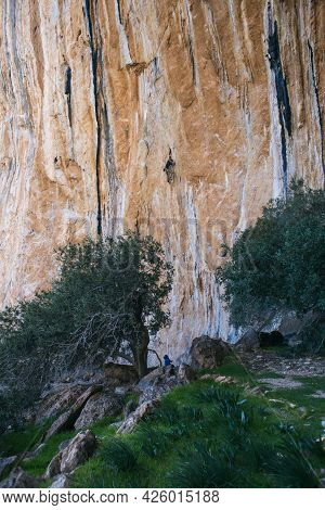 The Climber Climbs The Route. Man And Woman Are Engaged In Rock Climbing In Nature. Fitness In Natur