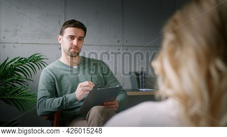Young patient at the reception of a professional psychotherapist