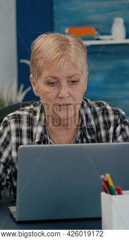 Old Middle Aged Businesswoman Working At Laptop From Home, Senior Mature Woman Typing On Pc Financia