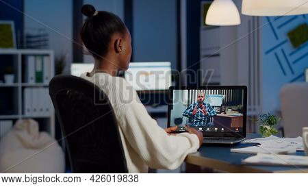 African Businesswoman Having Corporate Meeting With Remotely Paralyzed Man Using Webcam Of Laptop Si