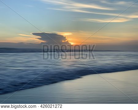 Sunset On The Beach View. Sunset Sunrise Over The Blue Sea Background. Colorful Sunrise Background.