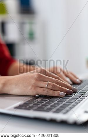 Close Up Of Businesswoman Manager Hands Fingers Typing Documents On Laptop Keypad. Detail Shot Of Et