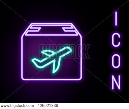 Glowing Neon Line Plane And Cardboard Box Icon Isolated On Black Background. Delivery, Transportatio