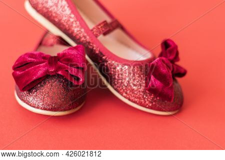 Shiny Red Ballerinas With Velvet Bows On Red Background