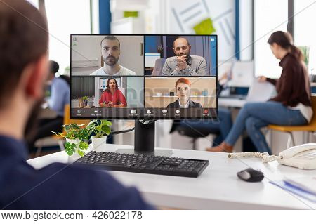 Paralysed Handicapped Businessman Sitting Immobilized In Wheelchair Having Videomeeting Discussing O