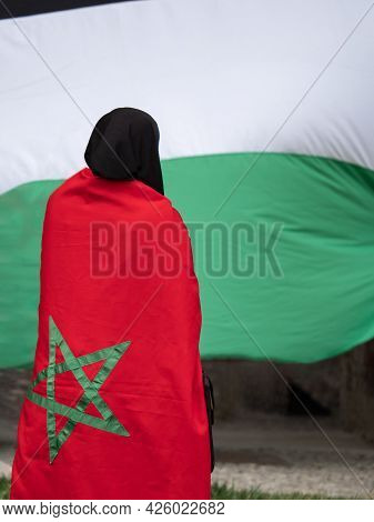 Girl With Moroccan Flag On Her Shoulders And Palestine State Flag On Background During A Political D