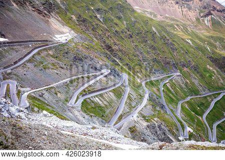 Stelvio Mountain Pass Or Stilfser Joch Scenic Road View, Border Of Italy And Switzerland