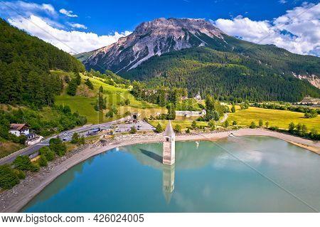 Submerged Bell Tower Of Curon At Graun Im Vinschgau On Lake Reschen Alpine Landscape Aerial View, So