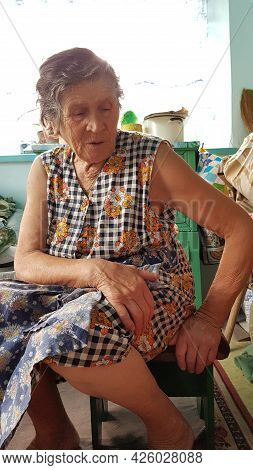 Senior Woman With Hand On Her Knees. Senior Woman In Upset Mood. 80s Granny In Sad Emotions. Geriatr