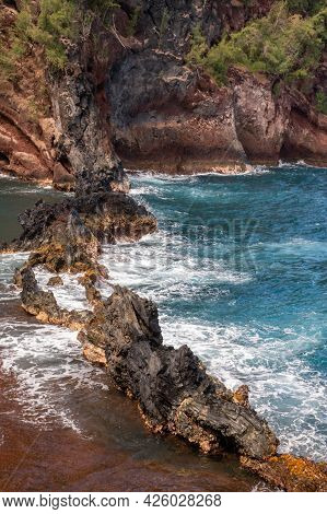 Sea Coast With Rocky Cliffs. Blue Water And Big Stones On The Seashore. Rocks On The Coast, Summer B