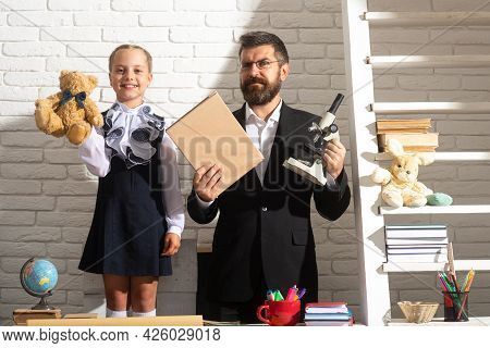 Teacher Dad Working With Creative Child Girl. Kids Education, Elementary School And Learning Concept