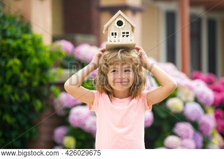 Funny Kid Hold Toy Little House. Child Making A New Dream Home. Family Home Dream. Adorable Child Wi