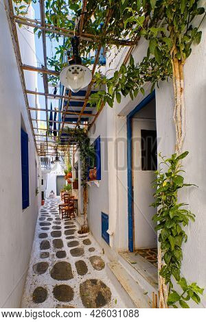 Beautiful Traditional Alleyways Of Greek Island Towns. White Walls, Blue Balconies And Doors, Cobble