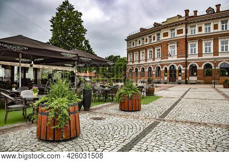 Latvia, Cesis, August, 2020 - Modern Architecture With Reconstructed Buildings From Old Red Bricks A