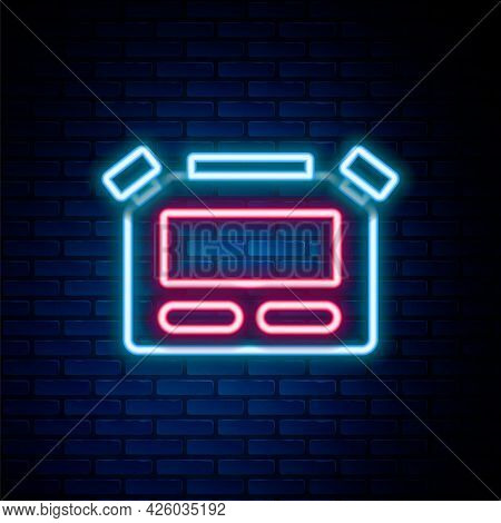 Glowing Neon Line Stopwatch Icon Isolated On Brick Wall Background. Time Timer Sign. Chronometer Sig