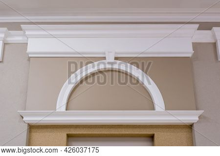 Detail Of Corner Ceiling With Intricate Crown Molding On Column