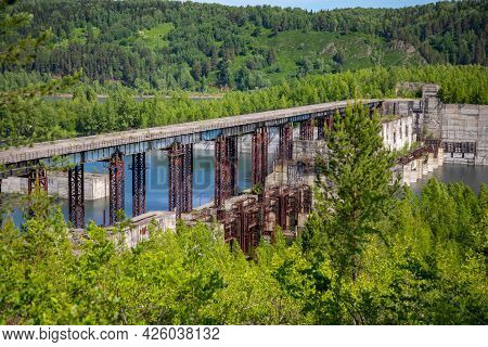 View Of Abandoned Hydroelectric Power Plant On The Taidon River, Siberia, Russia